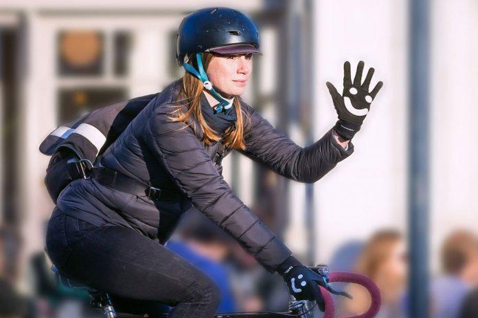 Cyclist waving wearing Glove
