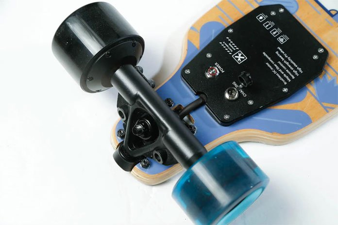 Lower gravity with drop through deck