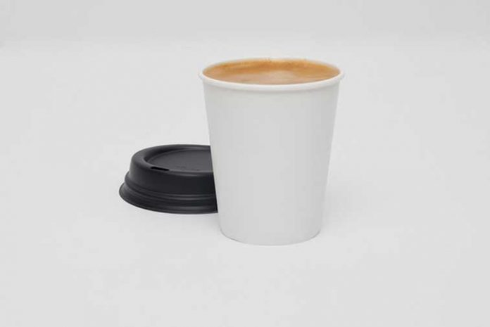 Tree-free calcium paper disposable cup filled with coffee