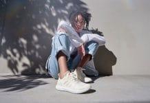 A girl wearing Futurecraft Loop Shoes