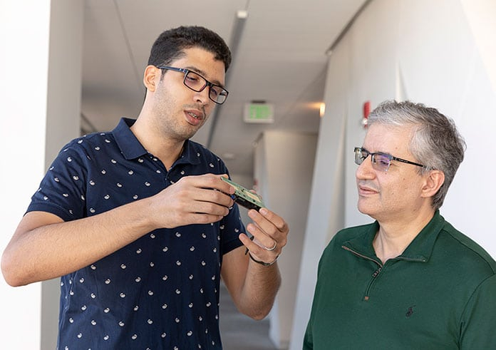 Seifallah Jardak (left) discusses his radar device with supervisor Mohamed-Slim Alouini.