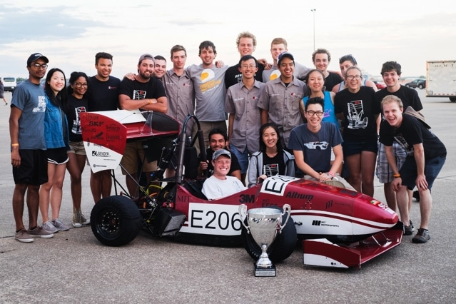 The MIT Motorsports team is all smiles with their Second Place Overall Spirit of Excellence Award silver trophy at the Formula SAE Electric competition in Lincoln, Nebraska. Photo courtesy of MIT Motorsports