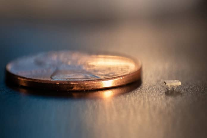 A micro-bristle-bot is shown next to a U.S. penny for size comparison./ Iamge: Georgia Tech