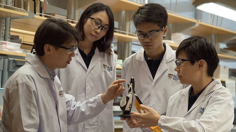 The ACES developed by Asst Prof Tee (far left) and his team responds 1000 times faster than the human sensory nervous system/ Image: NUS