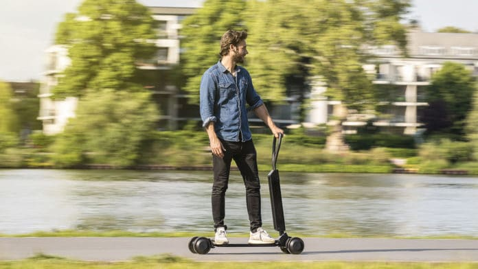 Audi combines e-scooter with skateboard. Image Credit: Audi