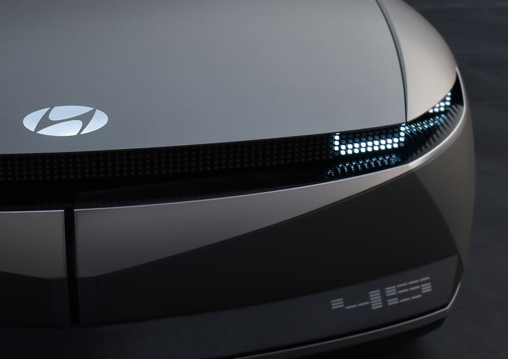 Active LED light strips on the car's exterior.