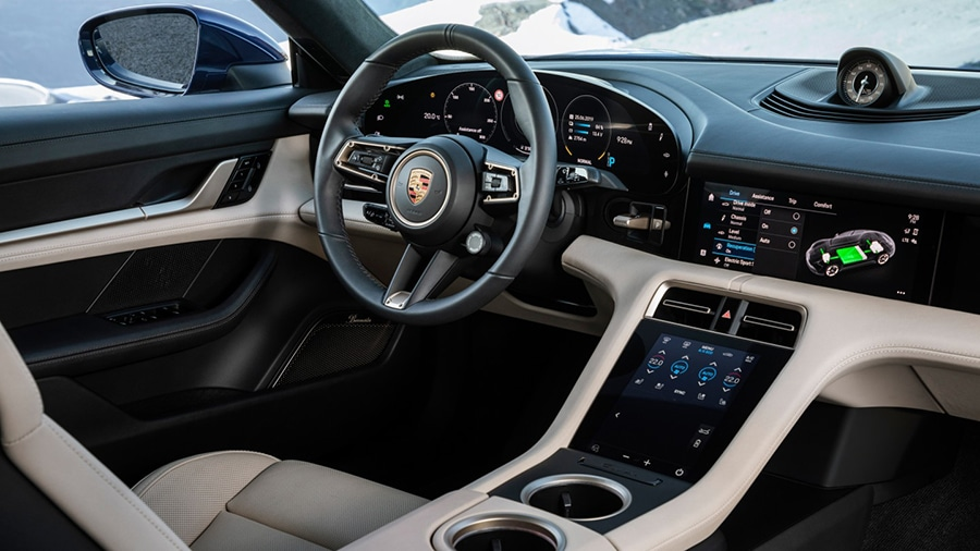 Unique interior design with a wide display screen band. Image Credit: Porsche