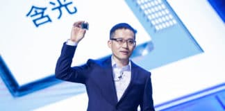 Jeff Zhang, Alibaba Group CTO shows the company's first AI inference chip called Hanguang 800.