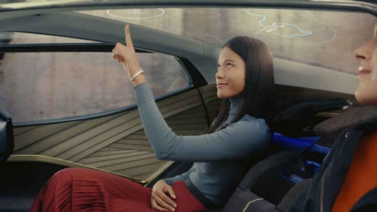 "A glass roof above the rear seats features voice control and a gesture controlled ""SkyGate"" display window"
