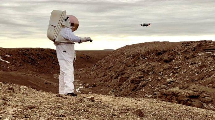 "Demonstration at the NASA Haughton-Mars Project field research site on Devon Island, High Arctic, of how an ""Astronaut Smart Glove"" might allow future astronauts on the Moon, Mars or beyond to single-handedly teleoperate even complex robotic assets such as drones."