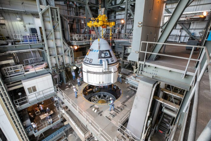 The Boeing CST-100 Starliner spacecraft is guided into position above a United Launch Alliance Atlas V rocket at the Vertical Integration Facility at Space Launch Complex 41 at Florida's Cape Canaveral Air Force Station. Credit: NASA