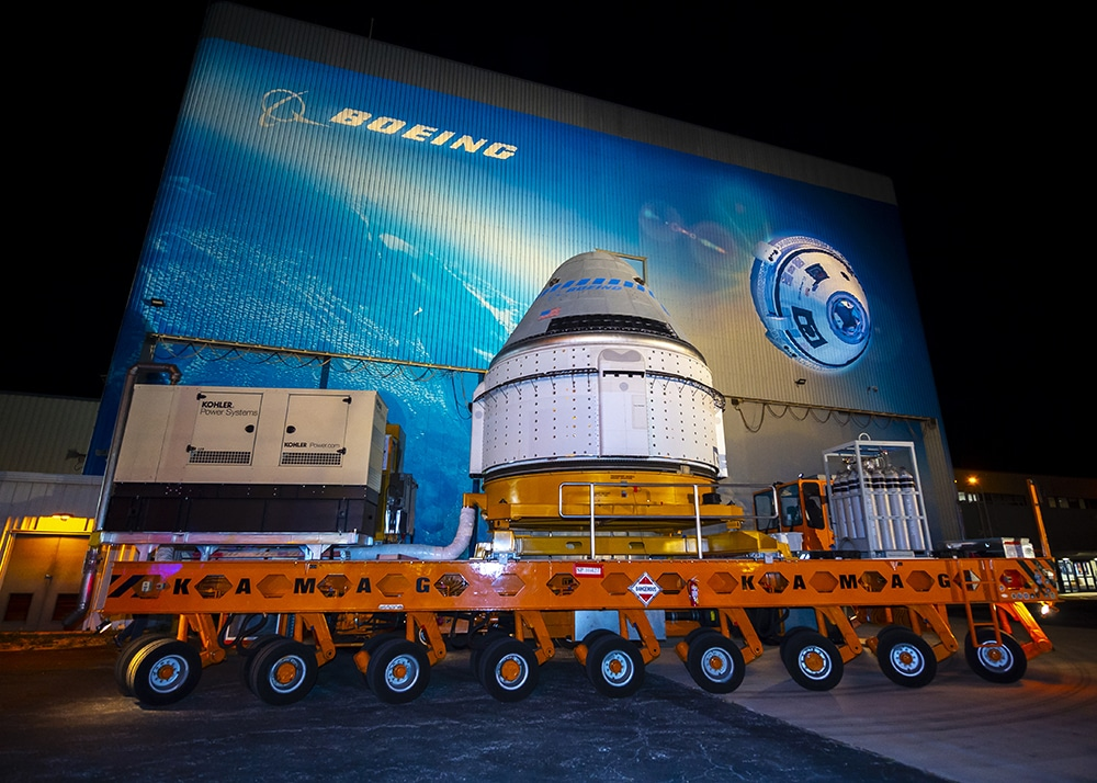 The Boeing CST-100 Starliner spacecraft rolls out from the company's Commercial Crew and Cargo Processing Facility at NASA's Kennedy Space Center in Florida. Credits: Boeing