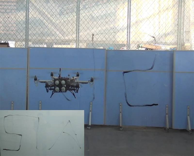 The hexacopter drone perform writing task.