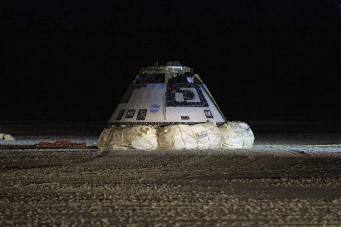 The Boeing CST-100 Starliner spacecraft is seen after it landed in White Sands, New Mexico, Sunday, Dec. 22, 2019. Credits: NASA/Bill Ingalls