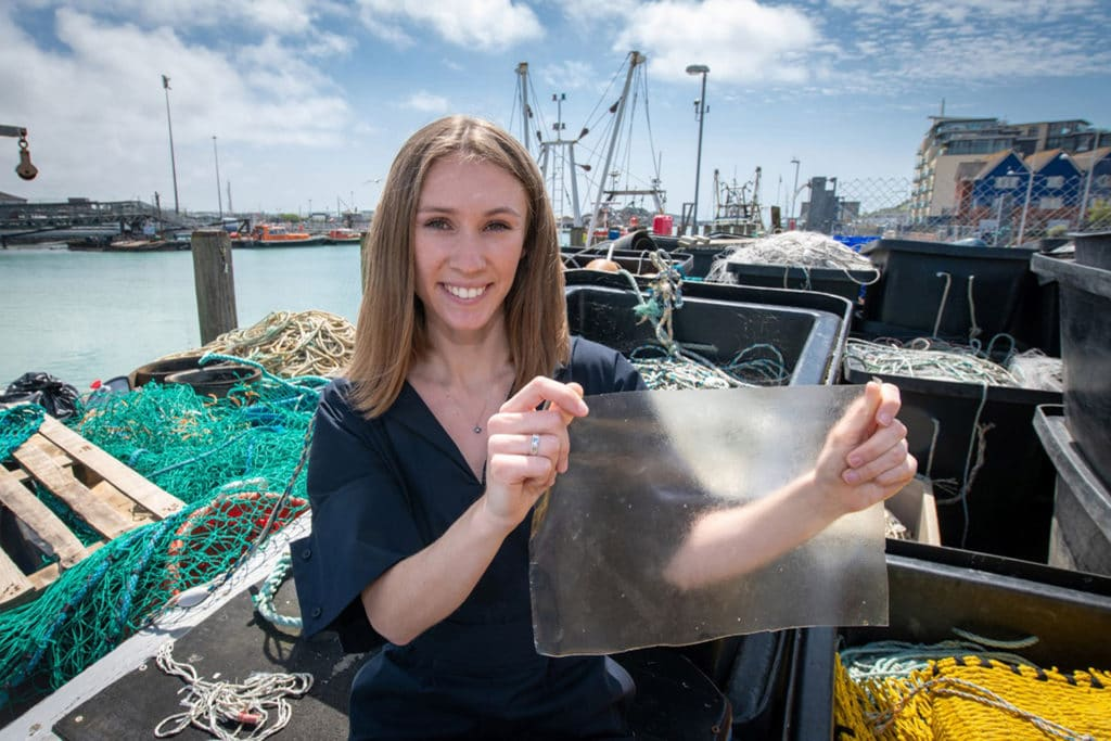 Product design student Lucy Hughes has invented a bioplastic created from fish skin and scales and red algae. Credit: University of Sussex