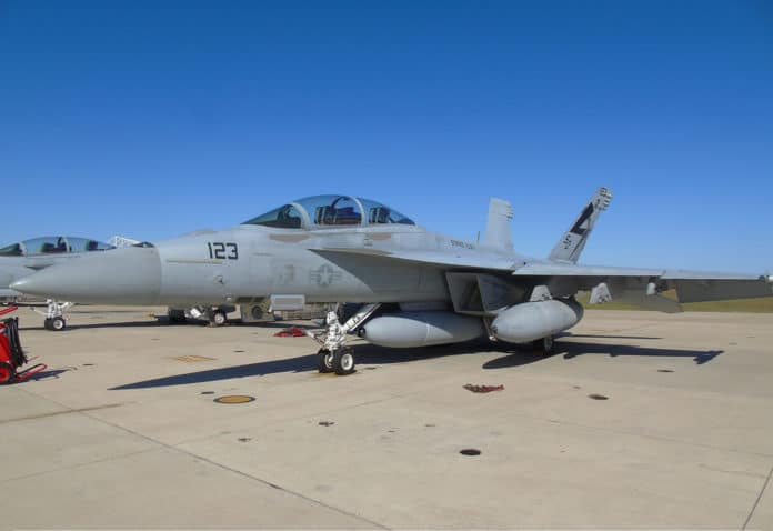 An F/A-18 Super Hornet equipped with a Block II Infrared Search and Track prepares for its first flight with the long-range sensor.