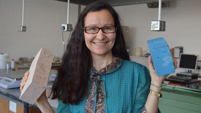 Professor Gabriela Medero with sustainable building bricks.
