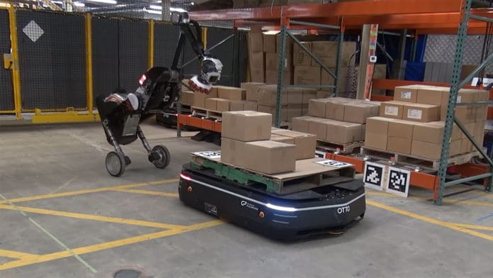 Otto Motors puts Boston Dynamics' Handle robot to work in its warehouse.