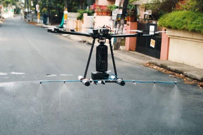 Garud drone spraying disinfectants on a street.