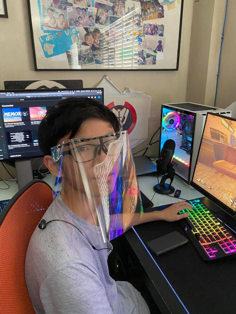 The 16-year-old Marcus Chu with his 3D-printed face shield