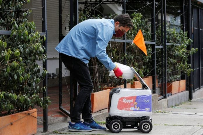 Rappi robots make home deliveries to avoid direct contact between people.