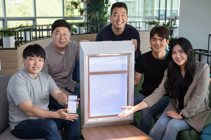 The SunnyFive team with their window that can generate artificial sunlight.