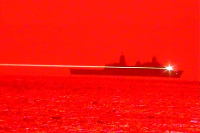 USS Portland conducts laser weapon system demonstrator test.
