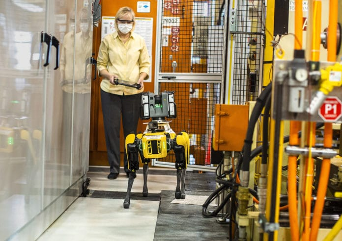 Paula Wiebelhaus, Fluffy's handler, navigates Fluffy, the dog-like robot through tough-to-reach areas within the plant.