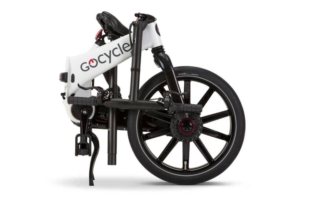 The rider can roll the collapsed ebike along on the side-by-side wheels.
