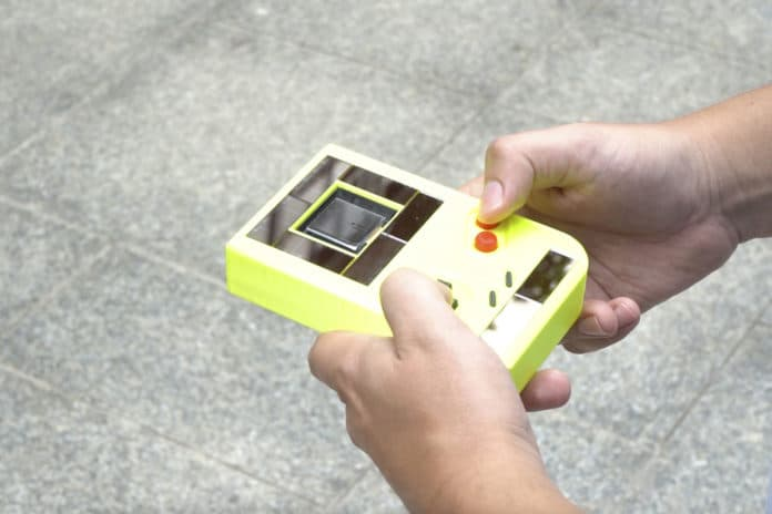 Battery-free Game Boy harvests energy from the sun and the user.