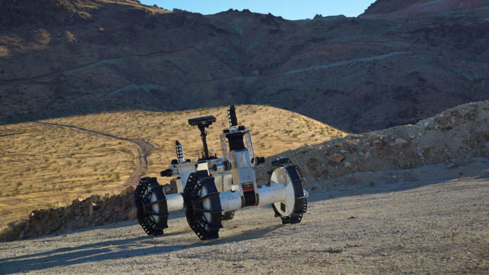 The DuAxel rover is seen here participating in field tests in the Mojave Desert.