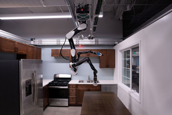 Toyota's Gantry robot hangs from the ceiling to perform household chores.