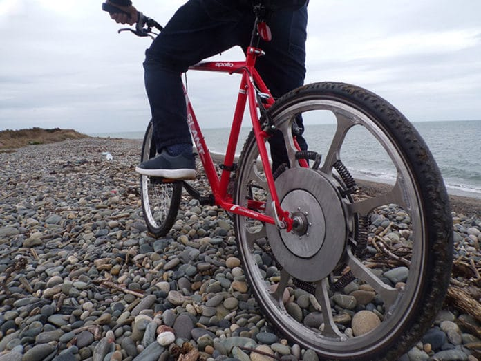 SuperWheel turns your bike into a power-assisted bike with unlimited range.