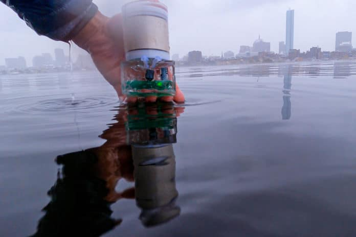This photo shows the battery-free sensor encapsulated in a polymer before it is dipped into the Charles river.