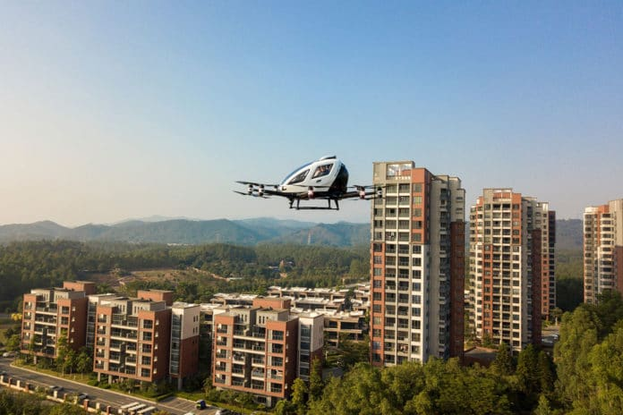 EH216 flying across the estate project, Forest Lake.