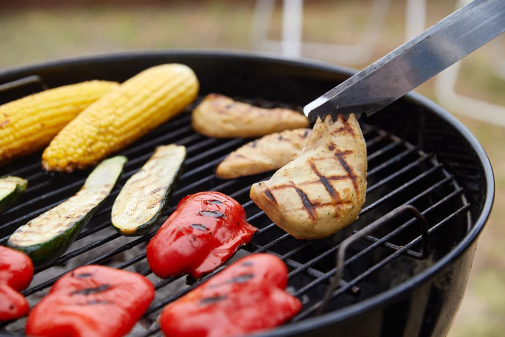 GOOD Meat Cultured Chicken on a grill.