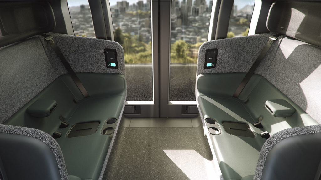 The vehicle features a four-seat, face-to-face symmetrical seating configuration.