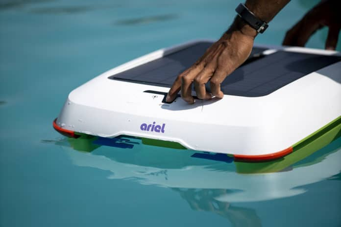 A solar-powered Ariel robot pool cleaner wipes out the debris.