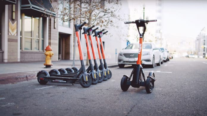 Spin's 3-wheeled e-scooters can be operated remotely to prevent sidewalk clutter.