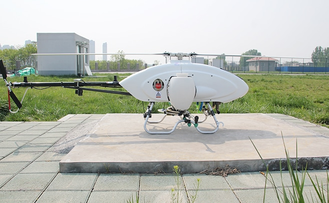 This long endurance autonomous helicopter sprays crops with high efficiency.