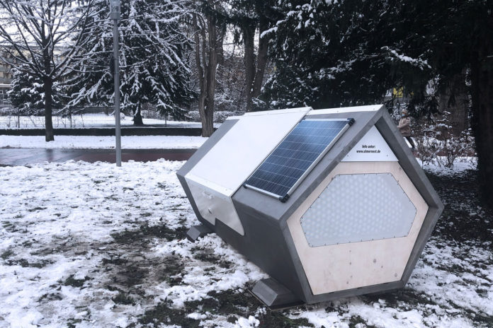 A German city tests solar-powered sleeping pods to protect homeless people in winter.