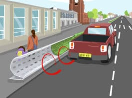 Curved roadside barrier design mitigates air pollution