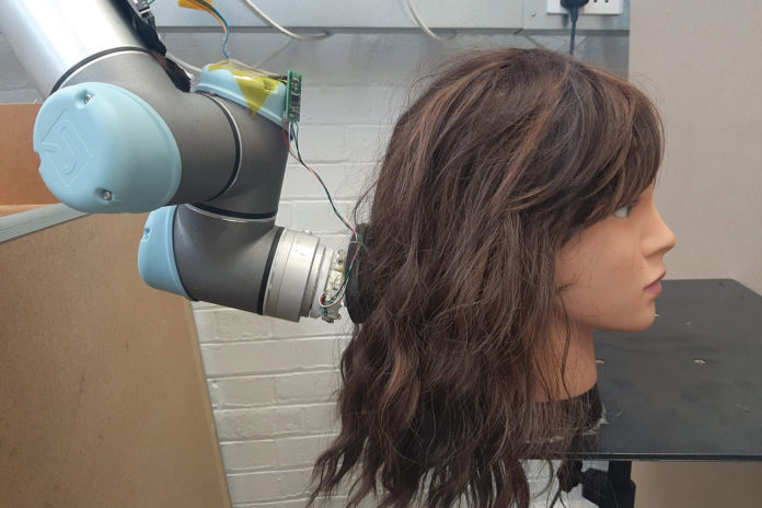 MIT's RoboWig could help people with disabilities untangle their hair.