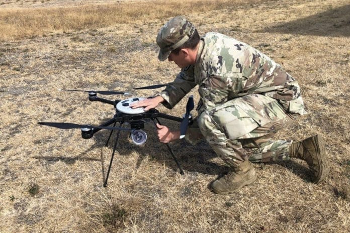Sgt. Traice R. Prentice, a U.S. Army Explosive Ordnance Disposal technician from the 707th Ordnance Company (EOD), prepares a Skyraider Unmanned Aerial System during field testing.