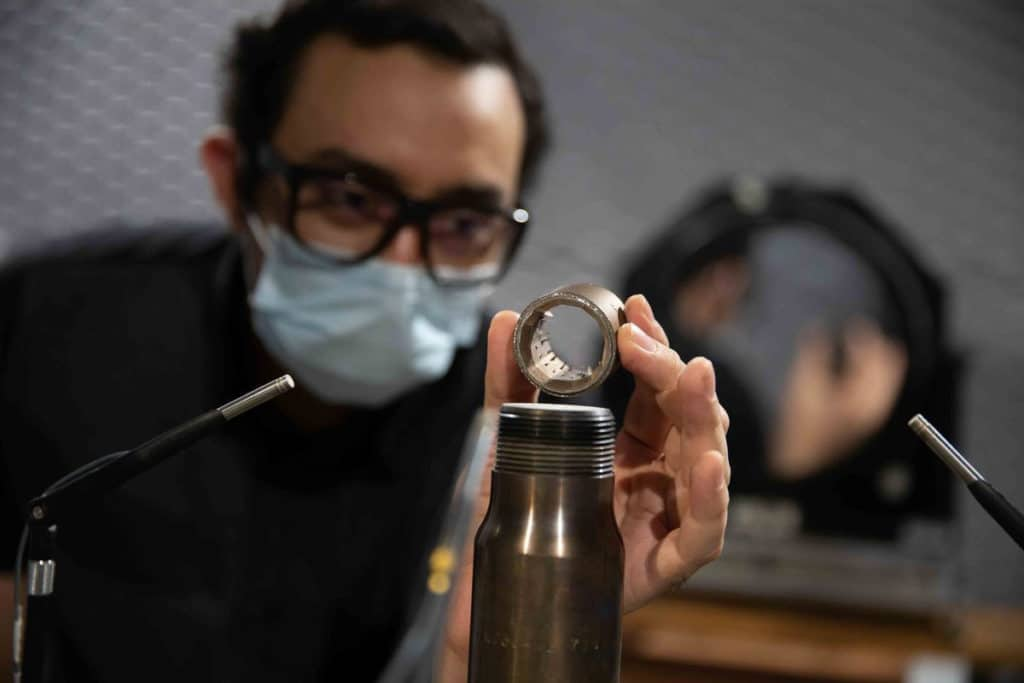 UC College of Engineering and Applied Science doctoral student Mohammad Saleem holds one of the novel jet engine nozzles.